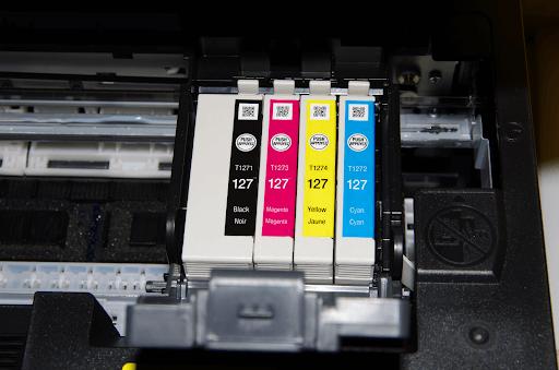 Epson 127-series (high yield) ink cartridges installed in an Epson WorkForce WF-3540 inkjet printer.
